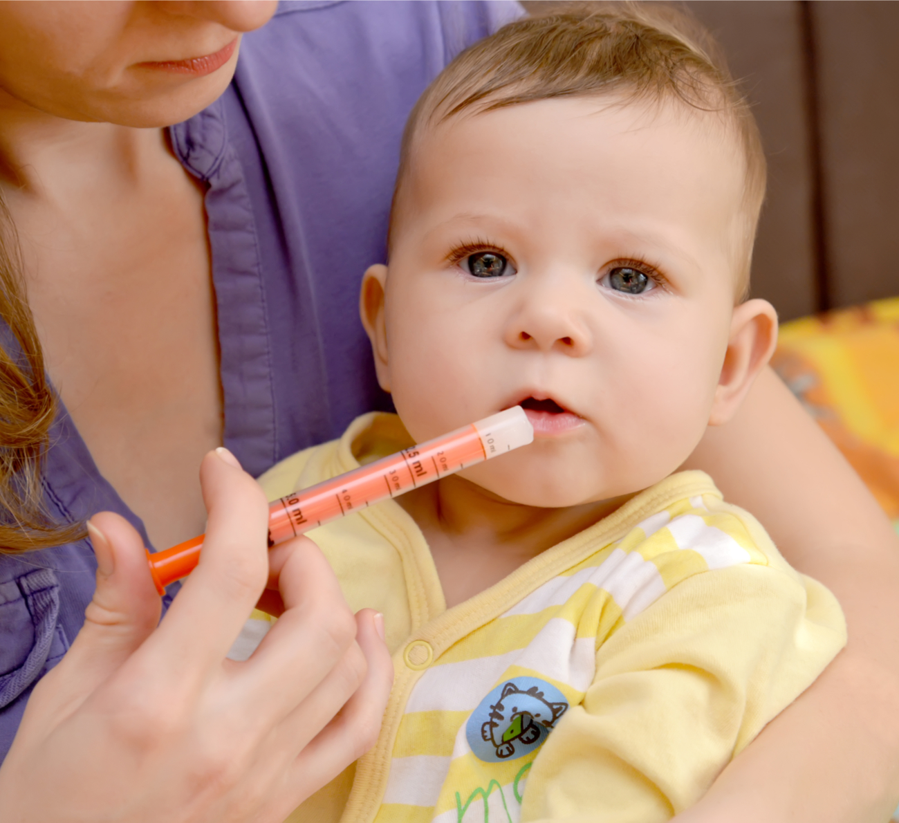 dar remédio para o bebê