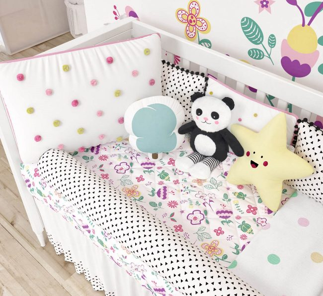 quarto de bebê com pompons